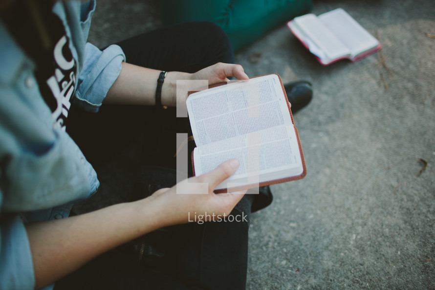 reading from a pocket bible