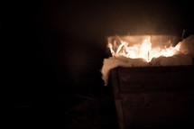 bokeh Christmas lights in a glowing manger