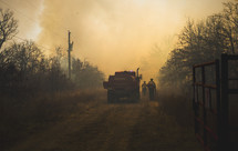 Forest fire rescue workers approaching fire