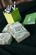 pens and Holy Bibles