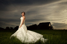 Bride in grass field