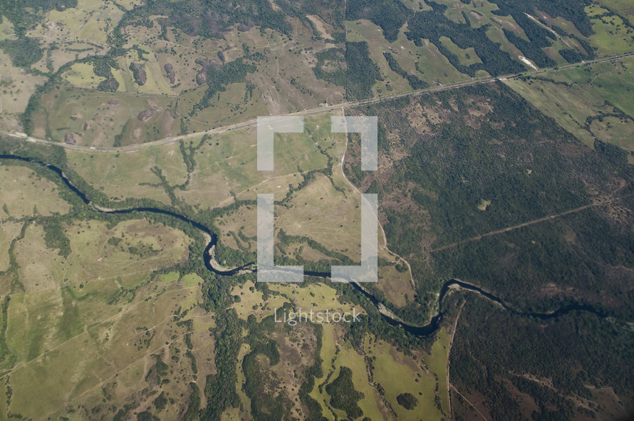 An aerial view of a river cutting through the land