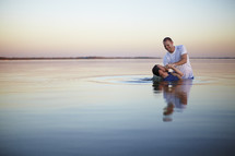 Man getting baptized on river