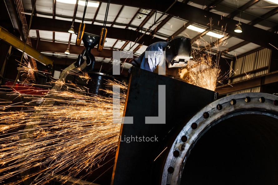 Sparks from a Man welding welder hood steel industrial