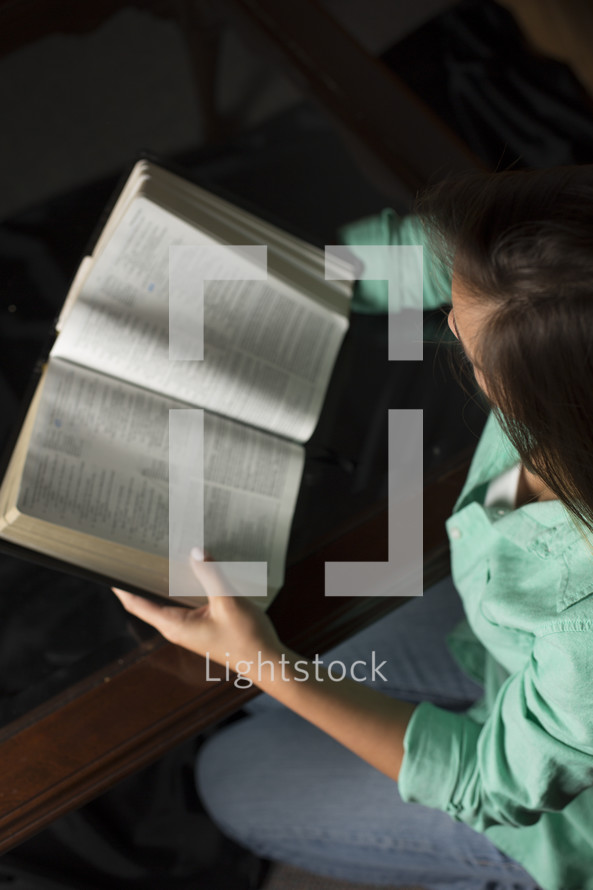 a woman reading from the Bible