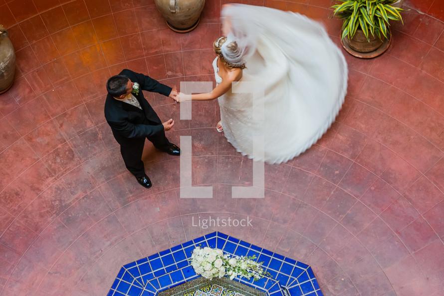 Bride and groom dancing wedding dress twirling twisting turning