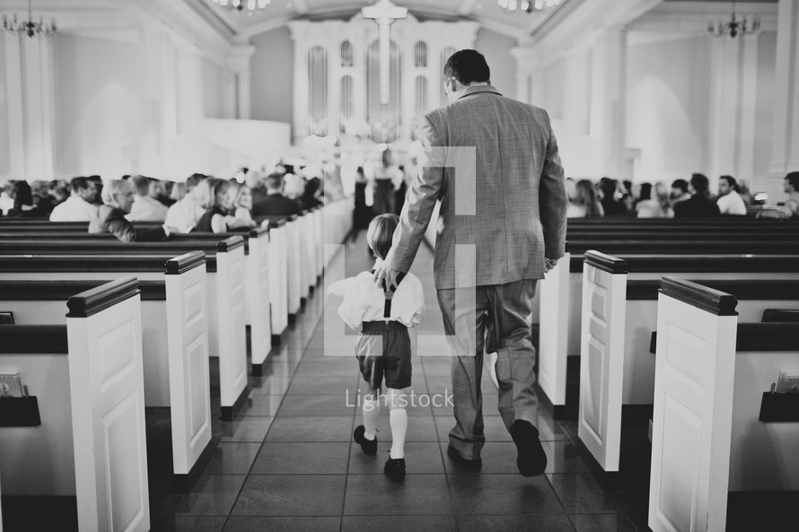 Father and son walking down the aisle