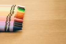 rainbow border of crayons