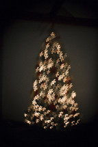 Christmas tree of illuminated whie doves.