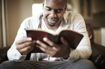 An African American man enjoying his Bible