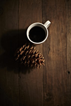 coffee cup and pine cone