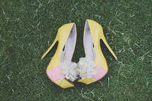 pair of yellow stilettos in the grass