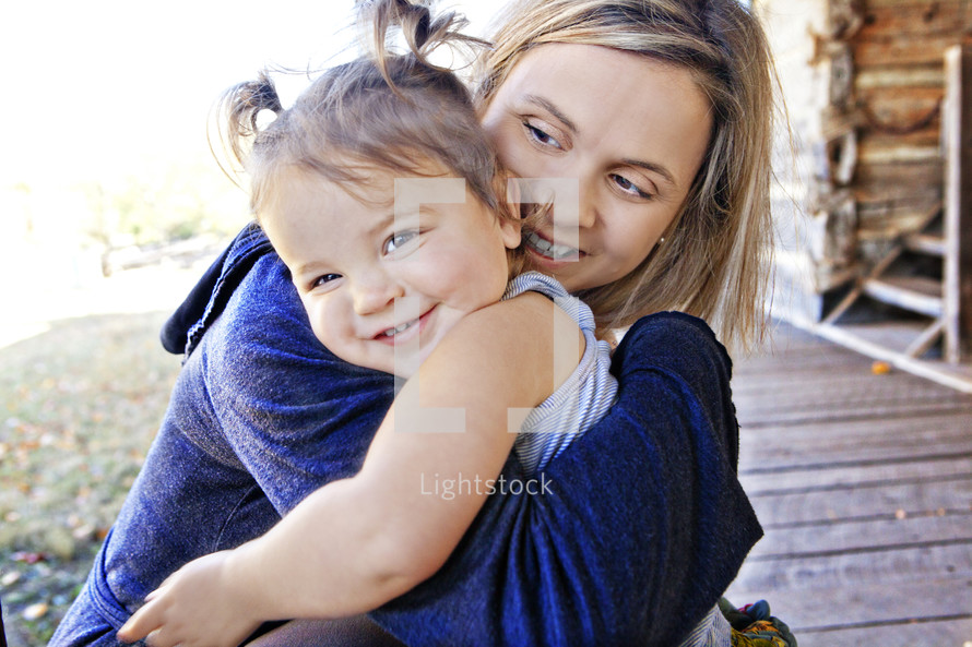 A mom and daughter hugging