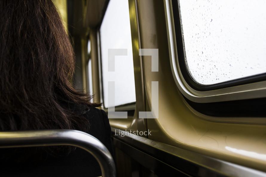 woman sitting on a subway train