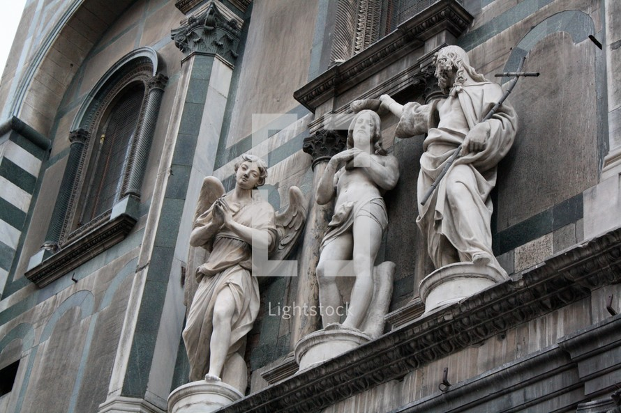Stone statues on a building