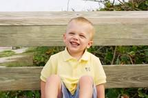 Boy sitting on park bench