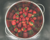 strawberries in a colander