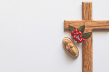 wooden cross with red berries