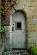 door in an arched doorway