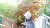 a woman walking down steps