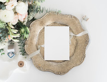 stationary on a silver tray, spool of ribbon, and bouquet for wedding invitations