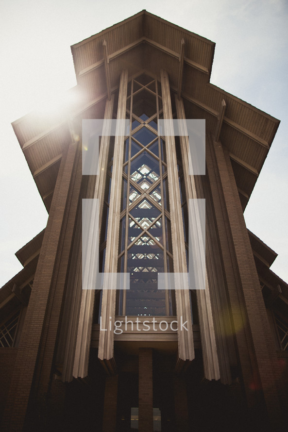 The sun shines brightly on the exterior of a church