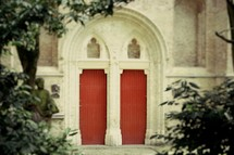 red doors on a church