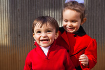 A little boy and girl laughing