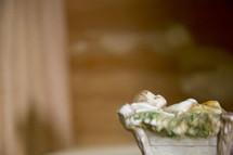 Porcelain figure of baby Jesus