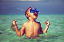Little boy snorkeling in the ocean