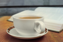 tea cup and open Bible