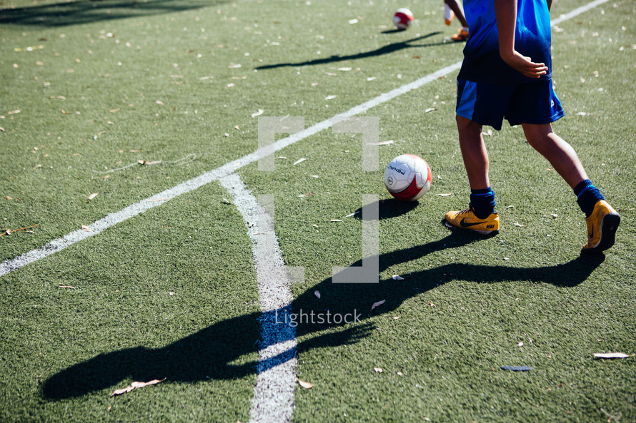 a boy on a soccer field