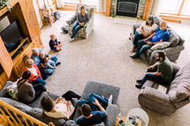 fellowship of families in a home for a prayer meeting