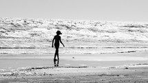 silhouette walking on a beach