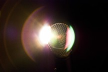 Shure microphone with stage light lens flare.