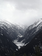 a wintry mountain scene, river in a valley