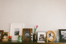 framed pictures on a mantle