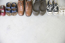 row of a family's shoes.