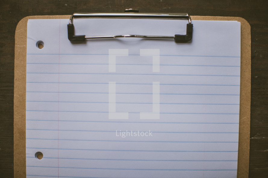 notebook paper on a clipboard