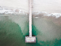 aerial view over an ocean pier