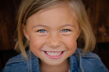 smiling face of a young girl child