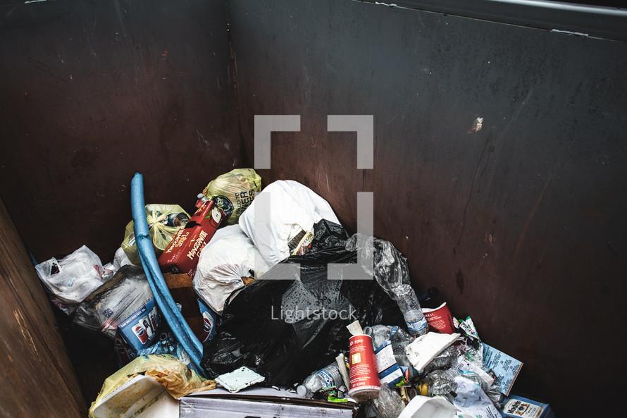 trash in a dumpster