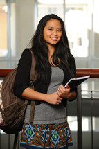 college student holding a notebook