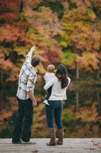 Family enjoying God's handywork. The father explaining the Fall colors.