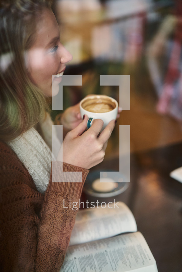 woman with coffee cup and open Bible