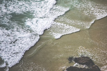 aerial view above waves in the ocean