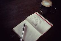pen lying on a journal