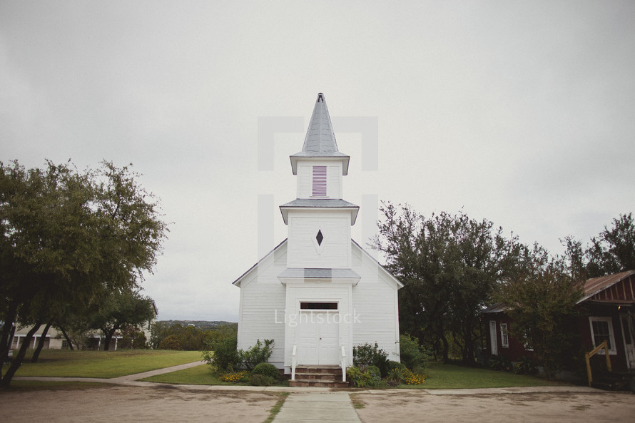 A small, white church in a rural area.
