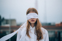 a blindfolded woman