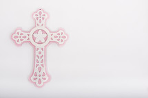 pink and white ornate cross